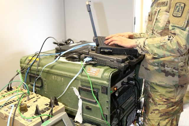 A U.S. Army Soldier works on U.S. Army Commercial Coalition Equipment (CCE) inside the U.K. command post during the Joint Warfighting Assessment (JWA) 18.1 at Grafenwohr, Germany, on May 2, 2018. CCE improves interoperability between allied nations, enabling secure tactical network access to the mission partner network and providing a network transport gateway for nations to contribute to the common operating picture.