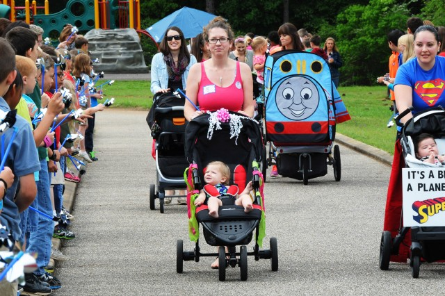 Parents take part in the stroller parade in 2016. The Fort Rucker New Parent Support Program will host this year's parade at the fun run and resiliency fair April 13 at 8 a.m. at the Fort Rucker Physical Fitness Center.