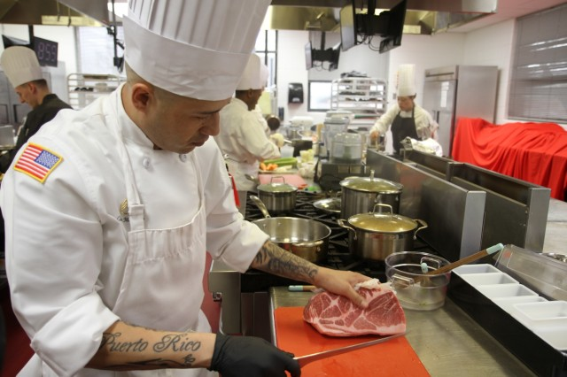 Staff Sgt. Carlos Mercado, advanced culinary NCO, prepares to make cuts for a braised beef-based appetizer during the Joint Culinary Training Exercise's Armed Forces Chef of the Year category March 8, at the Joint Culinary Center of Excellence on Fort Lee, Virginia. The Isabela, Puerto Rico native serves in 426th Brigade Support Battalion, 1st Brigade Combat Team, 101st Airborne Division (Air Assault). The 44th annual JCTE, administered by the Joint Culinary Center of Excellence, started March 9, and ended March 14. The exercise is the largest American Culinary Federation-sanctioned competition in North America and showcases the talent of more than 200 military chefs from around the world. (U.S. Army photo by Pfc. Lynnwood Thomas, 40th Public Affairs Detachment)
