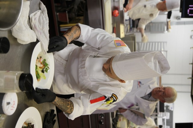 Staff Sgt. Carlos Mercado, advanced culinary NCO, prepares a salad for judges, as the first of a four-course meal, during the Joint Culinary Training Exercise's Armed Forces Chef of the Year category March 8, at the Joint Culinary Center of Excellence on Fort Lee, Virginia. The 44th annual JCTE showcases the talent of more than 200 military chefs from around the world as the largest American Culinary Federation-sanctioned competition in North America. The exercise, administered by the Joint Culinary Center of Excellence, started March 9, and ended March 14. Mercado, an Isabela, Puerto Rico native, serves in 426th Brigade Support Battalion, 1st Brigade Combat Team, 101st Airborne Division (Air Assault). (U.S. Army photo by Pfc. Lynnwood Thomas, 40th Public Affairs Detachment)