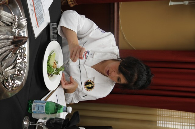 Jill Bosich samples a salad to critique as a judge in the Joint Culinary Training Exercise's Armed Forces Chef of the Year category March 8, at the at the Joint Culinary Center of Excellence on Fort Lee, Virginia. The salad was prepared by a Chef of the Year contender from the Fort Campbell Culinary Arts Team. Bosich is also a national chairperson for the American Culinary Federation. The 44th annual JCTE showcases the talent of more than 200 military chefs from around the world as the largest ACF-sanctioned competition in North America. The exercise, administered by the Joint Culinary Center of Excellence, started March 9 and ended March 14. (U.S. Army photo by Pfc. Lynnwood Thomas, 40th Public Affairs Detachment)