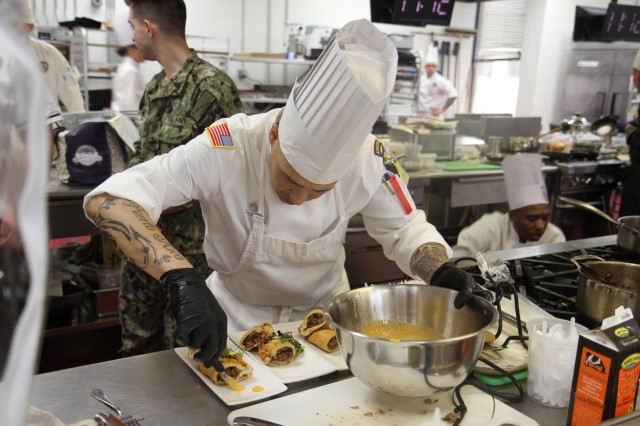 Staff Sgt. Carlos Mercado, advanced culinary NCO, prepares empanadas as the appetizer of a four-course meal during the Armed Forces Chef of the Year category in the Joint Culinary Training Exercise March 8, at the at the Joint Culinary Center of Excellence on Fort Lee, Virginia. The Isabela, Puerto Rico native serves in 426th Brigade Support Battalion, 1st Brigade Combat Team, 101st Airborne Division (Air Assault). The 44th annual JCTE showcases the talent of more than 200 military chefs from around the world as the largest American Culinary Federation-sanctioned competition in North America. The exercise, administered by the Joint Culinary Center of Excellence, started March 9, and continued until March 14. (U.S. Army photo by Pfc. Lynnwood Thomas, 40th Public Affairs Detachment)