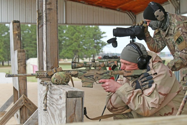 Rory Kennedy (on rifle) and Charles Hunt (on spotting scope) work together March 15 to identify a target during the SWAT Challenge at Fort Campbell, Ky. Kennedy and Hunt are both law enforcement officers with the Montgomery County (Tenn.) Sheriff's Office. The sniper marksmanship competition was the third of five events in the SWAT Challenge, this tested the physical, tactical and technical capabilities of multiple competing agencies.
