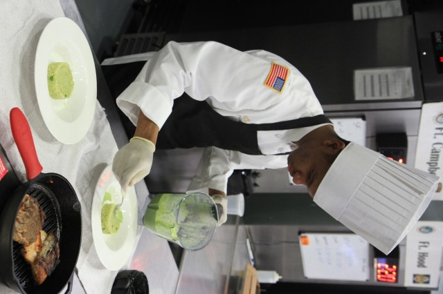 Pfc. Trevon Golden, a culinary arts specialist, prepares apple fennel coleslaw during the Joint Culinary Training Exercise's Student Chef of the Year category at Maclaughlin Fitness Center on Fort Lee, Virginia March 14. The St. Louis, Missouri native serves in 526 Brigade Support Battalion, 2nd Brigade Combat Team, 101st Airborne Division (Air Assault). As the largest American Culinary Federation-sanctioned competition in North America, the 44th annual JCTE showcases the talent of more than 200 military chefs from around the world. The exercise, administered by the Joint Culinary Center of Excellence, started March 9, and ended March 14. (U.S. Army photo by Pfc. Lynnwood Thomas, 40th Public Affairs Detachment)