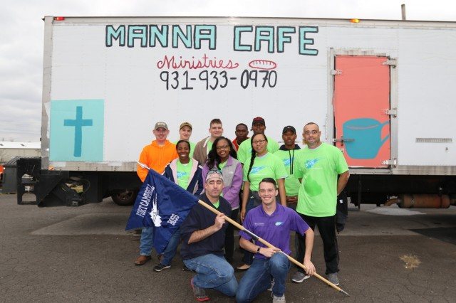 Fort Campbell's BOSS volunteers pose for a picture in front of the Manna Café Ministries truck after completing their duties at the Ministries' Warehouse Nov. 18.