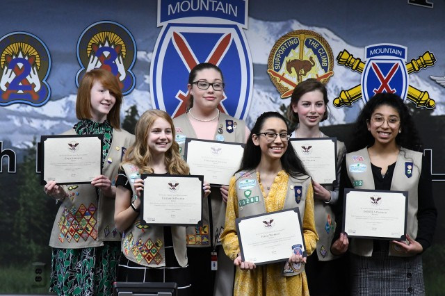 Six Fort Drum Girl Scouts, two troop leaders and two council members were presented with Presidential Service Awards from Maj. Gen. Walter E. Piatt, 10th Mountain Division (LI) and Fort Drum commander, during a ceremony April 1 at division headquarters. (Mike Strasser, Fort Drum Garrison Public Affairs)