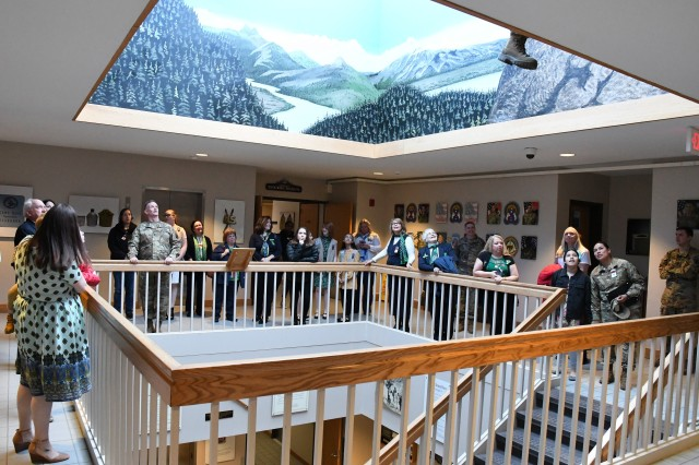 Maj. Gen. Walter E. Piatt, 10th Mountain Division (LI) and Fort Drum commander, leads a tour of division headquarters following an awards presentation for members of the Fort Drum Girl Scouts Service Unit 512 on April 1. (Mike Strasser, Fort Drum Garrison Public Affairs)