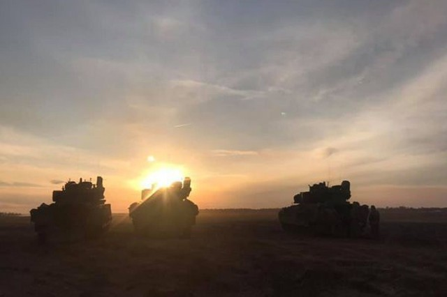 Soldiers from 1-64 Armor, 1ABCT, 3rd ID, stage their Bradley fighting vehicles during a platoon live-fire exercises in early March on Fort Stewart. (Photo by 1-64 Armor)
