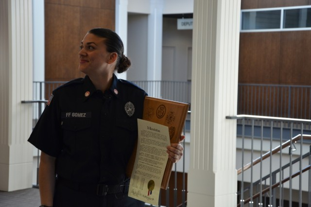 COLUMBUS, Ga. - Members of the Columbus, Georgia, city council unanimously recognized a firefighter at Fort Benning and others April 2 for an inter-community, international emergency exercise in 2018 that trained a class at the Western Hemisphere Institute for Security Cooperation (WHINSEC). In August 2018, Fort Benning firefighter Elizabeth Gomez and others participated as actors and facilitators during a simulated flood to teach military and civilian officers from WHINSEC about emergency operations during a natural disaster. (U.S. Army photo by Bryan Gatchell, Maneuver Center of Excellence, Fort Benning Public Affairs)