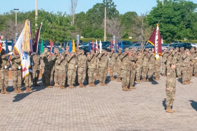 U.S. Army Reserve Maj. Gen. Mary E. Link, outgoing commanding general of Army Reserve Medical Command, relinquishes command to Maj. Gen. Jonathan Woodson, the new commanding general for ARMEDCOM headquartered in Pinellas Park, Florida, during a Change of Command ceremony held on Sunday, March 31, 2019.  The Change of Command ceremony symbolizes the continuation of leadership and unit identity despite the change of individual authority.  It also represents the transfer of power from one leader to another; passing the ceremonial flag from outgoing to incoming commander is a physical representation of that transfer. (Photo by Staff Sgt. Eric W. Jones)