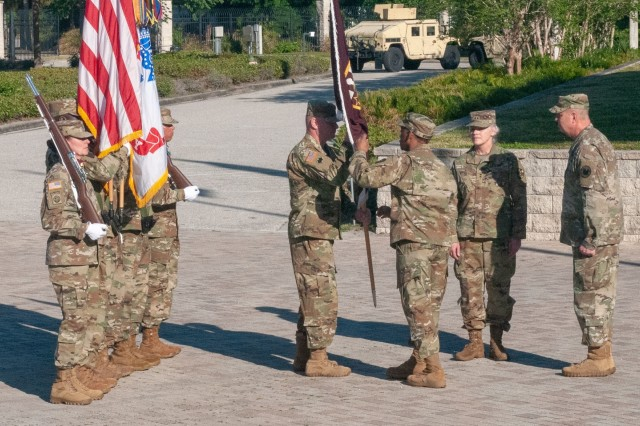 The incoming commanding general of Army Reserve Medical Command, Maj. Gen. Jonathan Woodson, passes the unit's colors to his command sergeant major, Command Sgt. Maj. Wayne Brewster, during the ARMEDCOM Change of Command ceremony. Maj. Gen. Scottie Carpenter, deputy commanding general for U.S. Army Reserve Command, presided over the ceremony on March 31, 2019, at the C. W. Bill Young Armed Forces Center in Pinellas Park, Florida. (U.S. Army Reserve photo by Staff Sgt. Eric W. Jones)