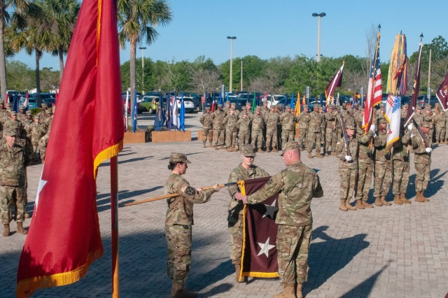 U.S. Army Reserve Maj. Gen. Mary E. Link, outgoing commanding general of Army Reserve Medical Command, cases her flag with the assistance of her command sergeant major, Command Sgt. Maj. Wayne Brewster, during the Change of Command ceremony held on March 31, 2019, at the C. W. Bill Young Armed Forces Center in Pinellas Park, Florida. (U.S. Army Reserve photo by Staff Sgt. Eric W. Jones)