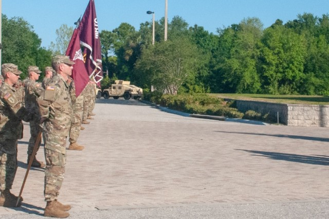 U.S. Army Reserve Maj. Gen. Mary E. Link, outgoing commanding general of Army Reserve Medical Command, relinquishes command to Maj. Gen. Jonathan Woodson, the new commanding general for ARMEDCOM headquartered in Pinellas Park, Florida, during a Change of Command ceremony held on Sunday, March 31, 2019.  The Change of Command ceremony symbolizes the continuation of leadership and unit identity despite the change of individual authority.  It also represents the transfer of power from one leader to another; passing the ceremonial flag from outgoing to incoming commander is a physical representation of that transfer. (Photo by Staff Sgt. Eric W Jones)
