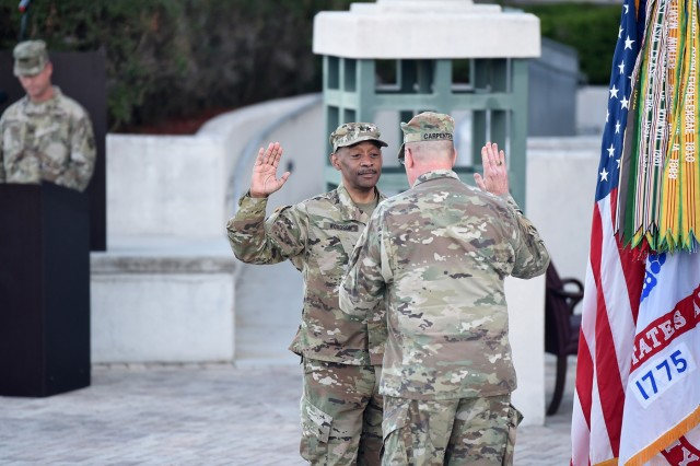 U.S. Army Reserve Maj. Gen. Jonathan Woodson, left, incoming commanding general of Army Reserve Medical Command, reaffirms his commissioned officer oath of service with Maj. Gen. Scottie Carpenter, deputy commanding general for U.S. Army Reserve Command, during a promotion ceremony, March 31, 2019. Carpenter presided over the ceremony at the C. W. Bill Young Armed Forces Center in Pinellas Park, Florida. (U.S. Army Reserve photo by Anthony L. Taylor)