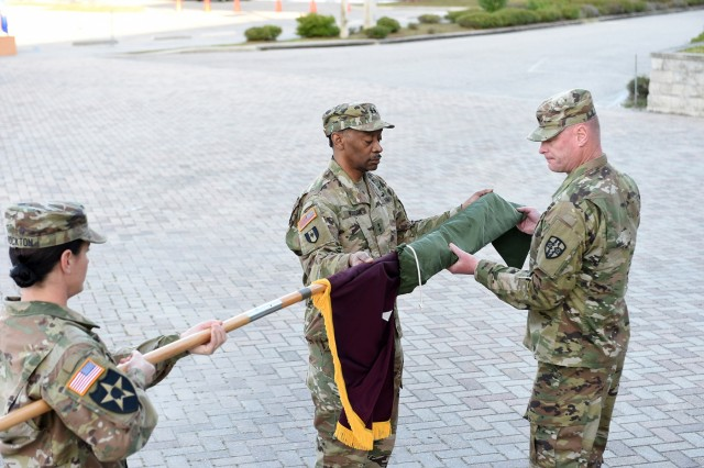 Maj. Gen. Jonathan Woodson, left, incoming commanding general of Army Reserve Medical Command, unfurls his two-star flag, with Command Sgt. Maj. Wayne Brewster, command sergeant major of ARMEDCOM, during his promotion ceremony to major general. Maj. Gen. Scottie Carpenter, Deputy Commanding General for U.S. Army Reserve Command, presided over the ceremony for Woodson which was held on March 31, 2019 at the C. W. Bill Young Armed Forces Center in Pinellas Park, Florida. (U.S. Army Reserve photo by Anthony L. Taylor)