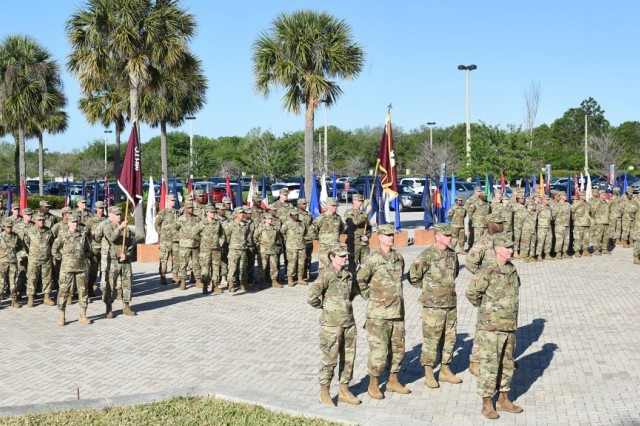 U.S. Army Reserve Soldiers assigned to Army Reserve Medical Command stand in formation during the command's Change of Command ceremony held in Pinellas Park, Florida, March 31, 2019. Maj. Gen. Mary E. Link, outgoing commanding general of ARMEDCOM, relinquished command to Maj. Gen. Jonathan Woodson, the incoming commanding general, during the ceremony.  The change of command ceremony symbolizes the continuation of leadership and unit identity despite the change of individual authority. It also represents the transfer of power from one leader to another; passing the ceremonial flag from outgoing to incoming commander is a physical representation of that transfer. (U.S. Army Reserve photo by Anthony L. Taylor)