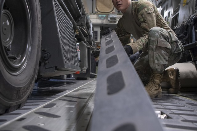 Master Sgt. Pat Wagnon, 62nd Aerial Port Squadron from Joint Base Lewis-McChord, assigned to Combined Joint Task Force-Horn of Africa, installs the floor rollers on board a C-17 supporting Combined Joint Task Force-Horn of Africa, in Maputo, Mozambique, April 2.