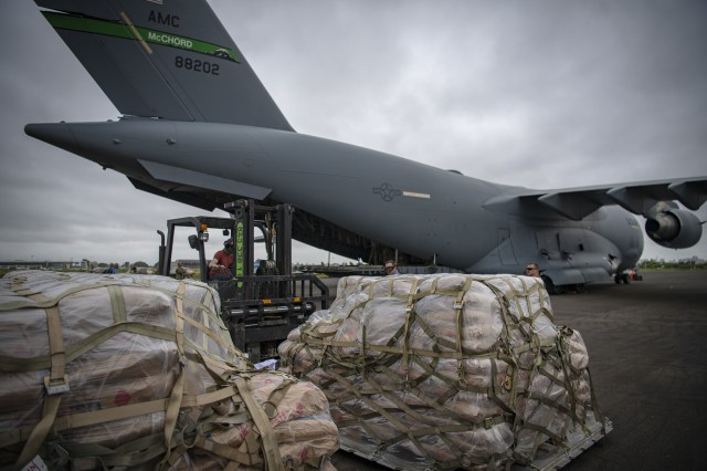 A 62nd Airlift Wing C-17 Globemaster III aircraft, on loan to Joint Base Charleston, S.C., delivers food aid from the United States Agency for International Development, supporting Combined Joint Task Force-Horn of Africa, in Maputo, Mozambique, April 2. The task force is helping meet requirements identified by USAID assessment teams and humanitarian organizations working in the region by providing logistics support and manpower to USAID at the request of the Government of the Republic of Mozambique.