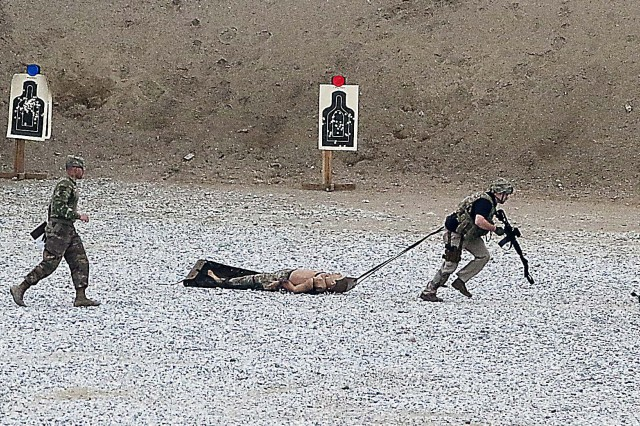 Army Criminal Investigation Command Special Agent Shawn Hemphill, Task Force Justice, drags a weighted human dummy to the next station during the Combat Skills Challenge March 30 at Maholic Range, Bagram Airfield, Afghanistan. (Photo by Jon Micheal Connor, Army Public Affairs)