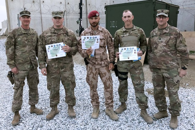 Sgt. 1st Class Martin Kolbabek (center), Czech Republic -- Task Force Lion, displays his certificate for first place, flanked to his right by Army Sgt. Christian Long, 264th Engineer Clearance Company , second place, and to Kolbabek's left, Army Sgt. 1st Class Cody Williams, third place, Joint Task Force Parwan. Far left is Army Master Sgt. Nicholas Blevins, range officer in charge, and far right is Lt. Col. David Markiewicz, deputy director, Joint Task Force Parwan, U.S. Forces -- Afghanistan. (Photo by Special Agent Joshua Kimrey, Criminal Investigation Command)