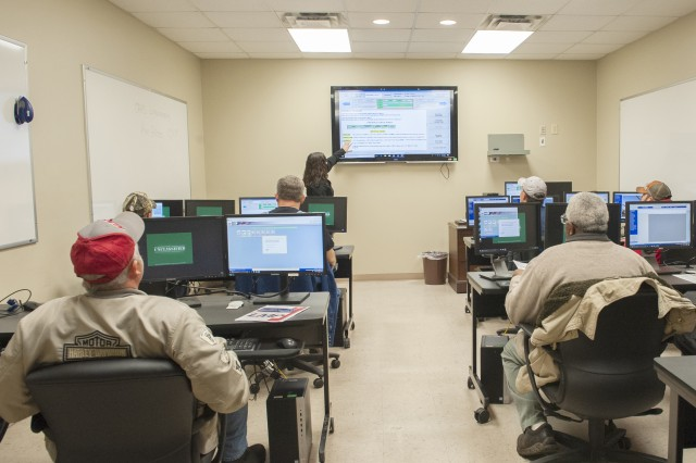 Kim Gibson instructs employees during an IBO 304, Artisan Shop Execution, class in the Systems Training Lab at Anniston Army Depot. The former LMP Lab is now used as a classroom.