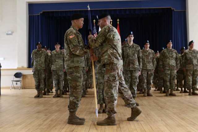 Capt. Ivan Cho, incoming commander, accepts the guidon and company leadership charge from Col. Adam Hilburgh, chief of staff for the 20th Chemical, Biological, Radiological, Nuclear, Explosives (CBRNE) Command, at his Mar. 31 assumption of command ceremony. Cho now commands the 264 Soldier Headquarters and Headquarters Company for the 20th CBRNE Command on Aberdeen Proving Ground.