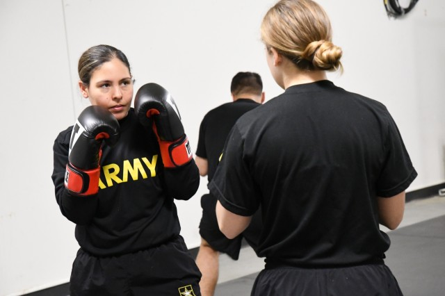 The 91st Military Police Battalion's Boxing Academy concluded April 4 with an exhibition of sorts as the boxers were cheered by dozens of their peers during their final evaluations. The 10-session training clinic was led by Lt. Col. Scott Blanchard, 91st MP Battalion commander, and assisted by Capt. Erin Kocher, battalion S2. Blanchard was previously a boxing and combatives instructor in the Department of Physical Education at the U.S. Military Academy at West Point. Kocher, a West Point Class of 2014 graduate, was a member of the academy's Women's Boxing Team. (Photo by Mike Strasser, Fort Drum Garrison Public Affairs)