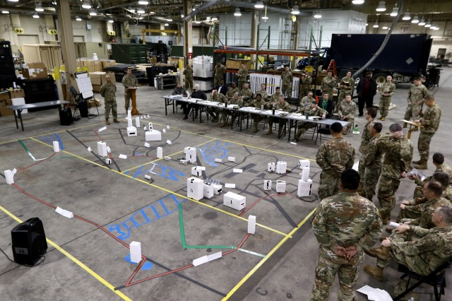 The leadership of the 20th Chemical, Biological, Radiological, Nuclear, Explosives (CBRNE) Command listen as briefers review the sequence of actions for the May 2019 move from Edgewood Area to the new headquarters complex on Aberdeen Proving Ground - North. The 20th CBRNE Command is moving into a new $73 million two-building headquarters complex at the corner of Havre de Grace and Cyber Streets.