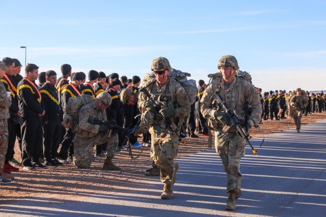 Expert Infantryman Badge candidates assigned to the 2nd Infantry Brigade Combat Team, 4th Infantry Division, complete a 12-mile ruck march, March 1, 2019, on Fort Carson, Colorado. The test was the last event for the week-long testing for the Soldiers. (U.S. Army photo by Staff Sgt. Neysa Canfield)