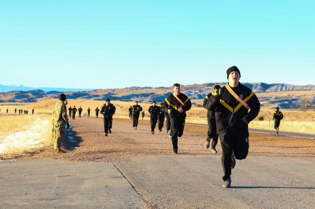 Expert Infantryman Badge candidates assigned to the 2nd Infantry Brigade Combat Team, 4th Infantry Division, perform a four-mile run while participating in the Army Physical Fitness Test, Feb. 25, 2019, on Fort Carson, Colorado. The test was the first event for the week-ling testing for the Soldiers. (U.S. Army photo by Staff Sgt. Neysa Canfield)
