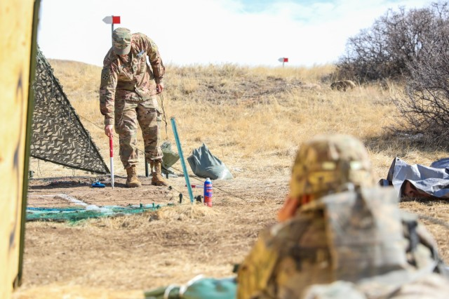 U.S. Army Staff Sgt. Pedro Moreno, an infantryman assigned to the 2nd Battalion, 12th Infantry Regiment, 2nd Infantry Brigade Combat Team, 4th Infantry Division, adjusts indirect fire for a candidate, Feb. 26, 2019, , at the Expert Infantryman Badge testing site on Fort Carson, Colorado. Infantryman throughout the brigade and other units on the installation are participating in the week long testing to earn the coveted badge. (U.S. Army photo by Staff Sgt. Neysa Canfield)
