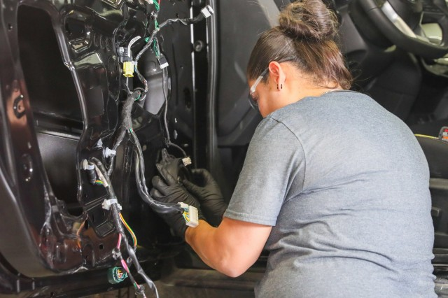 Sgt. Ana Lopez, a wheeled vehicle mechanic with Golf Company, 1st Battalion, 12th Infantry Regiment, 2nd Infantry Brigade Combat Team, 4th Infantry Division, works on a vehicle March 23, 2019, during her last week at Caliber Collision Academy in Falcon. Lopez, who is transitioning out of the Army, found the academy through the Soldier for Life-Transition Assistance Program.