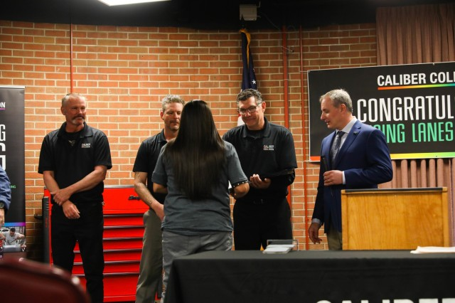 Sgt. Ana Lopez, a wheeled vehicle mechanic with Golf Company, 1st Battalion, 12th Infantry Regiment, 2nd Infantry Brigade Combat Team, 4th Infantry Division, receives her certificate March 29, 2019, from the Caliber Collision Academy after graduation. Caliber Collision teams with the Fort Carson Soldier for Life-Transition Assistance Program to help prepare Soldiers transitioning out of the Army.