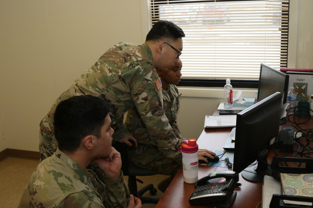 Lt. Sung K. Shin, the Commercial Vendor Services Chief/Disbursing Officer for Bravo Detachment of the 33rd Financial Management Support Unit here, gives the Soldiers guidance on processing foreign vendor contracts Mar. 28, 2019, on Fort Drum, NY.The unit is deployed in place to process all of the Commercial Vendor Services (CVS) contracts in support of the Central Command area of responsibility during a 9-month deployment from home.