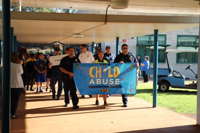 Community members pledged their commitment to preventing child abuse with a proclamation signing and pinwheel parade at Daniel K. Inouye Elementary School on Schofield Barracks, April 3, 2019.Joining elementary school staff and students and senior leadership was the Federal Fire Department, Honolulu Police Department, the garrison's Directorate of Emergency Services and the 25th Infantry Division Marching Band.