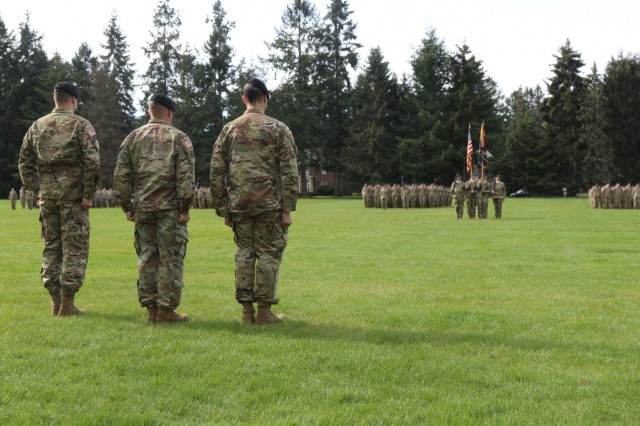 Col. Jay Miseli, 2nd Stryker Brigade Combat Team, 2nd Infantry Division commander, initiates the 2nd Battalion, 1st Infantry Regiment change of command ceremony with incoming commander, Lt. Col. Blake Wetherell (l) and outgoing commander, Lt. Col. Charles Ford (r) on Watkins Field, at Joint Base Lewis-McChord, WA, April 2, 2019.