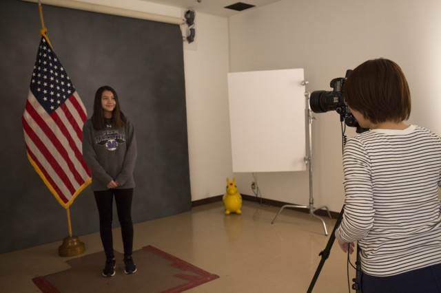 Momoko Shindo, right, shows Emma Flack, left, how she takes official photographs at the Visual Information Center during a job shadowing event at Camp Zama April 4.