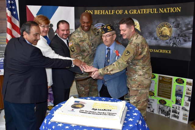 Participants cut the cake at the Ansbach Community Vietnam Veterans Commemoration event March 30, 2019. (f.l.t.r.: Raul Abrego, DeCA, Susan Housten, American Legion Post 1982, Cary Zottolo, AAFES, Command Sgt. Maj. Philson Tavernier, USAG Ansbach, Ken Aungst, American Legion & VFW, Col. Steven Pierce, USAG Ansbach commander)