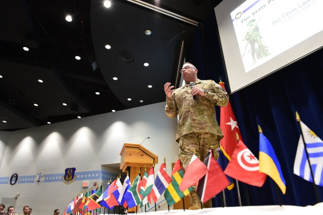 U.S. Army Brig. Gen. Chris Lawson, National Guard Bureau vice director, Strategy, Plans, Policy, and International Affairs, speaks with more than 100 attendees of the State Partnership Program workshop, April 2, 2019, at the Air National Guard's training and education center on McGhee Tyson Air National Guard Base in East Tennessee.