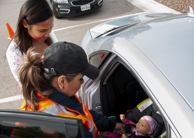 Fair demonstrates, educates proper car seat safety