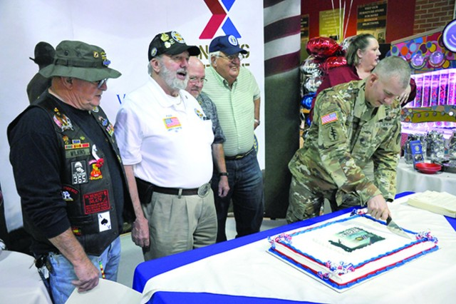 The Hunter Army Airfield garrison commander, Lt. Col. Kenneth Dwyer, cuts the cake at the Fort Stewart AAFES Vietnam Veteran Lapel Pin ceremony, March 29 on Fort Stewart.