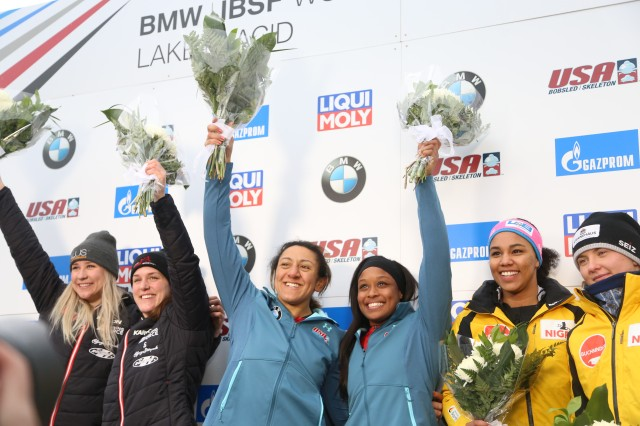 (Left to right) Elana Meyers and Lake Kwaza, in the center, celebrate winning second place in two-man bobsled at the 2019 Lake Placid Bobsled World Cup. Kwaza is considering joining WCAP after hearing about the program form. Cpt. Kohn.