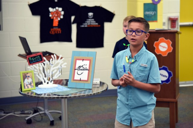 "Skyler Stevens, a 5th-grade student at Kolda Elementary School, Corpus Christi, Texas, presents his product or brand ""Get Hooked"" to a panel of judges during the 2nd Annual Kolda Elementary School Entrepreneur Quest competition, March 28. Stevens was one of 11 students competing to win the competition and a chance to win $100 towards the marketing of their idea."