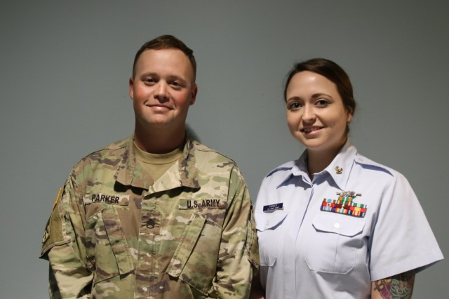 U.S. Army Staff Sgt. Nicholas Parker and his wife, U.S. Coast Guard Petty Officer Second Class Andrea Parker smile for a photo on February 4, 2019, at Andersen Air Force Base, Guam.
