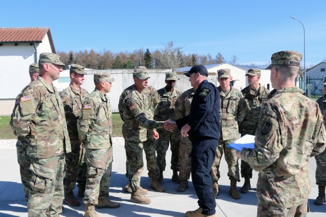 Soldiers assigned to the 372nd Engineer Company, U.S. Army Reserves, out of Pewaukee, Wisconsin, receive a coin from Lt. Col. Condon Michael, battalion commander of 1st Battalion, 4th Infantry Regiment, for their work in pouring a concrete pad for the battalion during their annual training at Joint Multinational Readiness Center in Hohenfels, Germany, April 4, 2019. The 372nd Soldiers poured a 30 by 40 foot concrete pad for 1st Bn., 4th Inf. Regt. to house a BeaverFit Box.