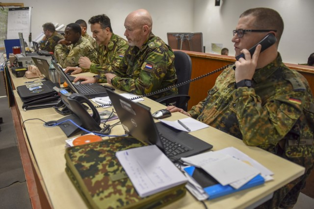Soldiers from the U.S., Netherlands, and Germany work together at the high command of Allied Spirit X in the Hohenfels Training Area April 4, 2019. Exercise Allied Spirit X includes approximately 5,630 participants from 15 nations, March 30 - April 17, 2019, at the 7th Army Training Command's Hohenfels Training Area in southeastern Germany. Allied Spirit is a U.S. Army Europe-directed, 7th Army Training Command-conducted multinational exercise designed to develop and enhance NATO and key partner interoperability and readiness across specified war fighting functions. (U.S. Army photo by Sgt. Christopher Stewart)