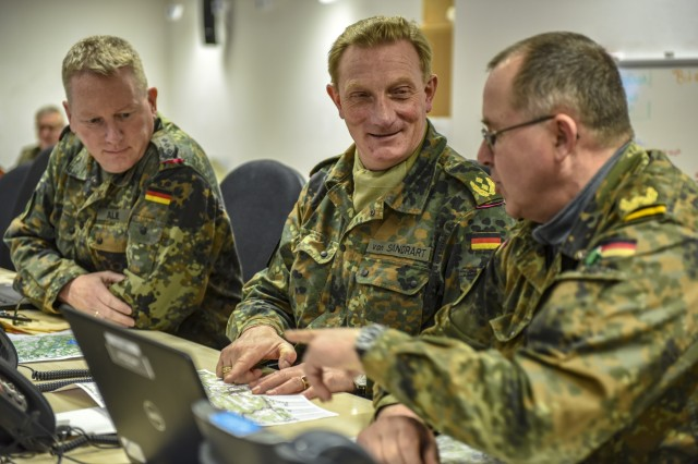Col. Thorsten Alme, the chief of staff for 1st Armored Division (1AD) of the Bundeswehr, Maj. Gen. Jürgen-Joachim von Sandrart, the commander of the 1AD, and Brig. Dieter Meyerhoff, the deputy commander and commander of troops for 1AD, discuss operations for exercise Allied Spirit X in Hohenfels Training Area, April 4, 2019. The 1st Armored Division is acting as the high command for this exercise, a first for the Allied Spirit series. Exercise Allied Spirit X includes approximately 5,630 participants from 15 nations, March 30 - April 17, 2019, at the 7th Army Training Command's Hohenfels Training Area in southeastern Germany. Allied Spirit is a U.S. Army Europe-directed, 7th Army Training Command-conducted multinational exercise designed to develop and enhance NATO and key partner interoperability and readiness across specified war fighting functions. (U.S. Army photo by Sgt. Christopher Stewart)