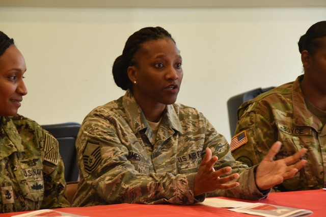 Air Force Master Sgt. Amber Grimes, section chief and vocalist for the SHAPE International Band, answers a question during the panel session at the Women's History Month observance, March 27, 2019, at SHAPE, Belgium. During the event, female leaders spoke about how they overcame adversity in the military and the importance of fostering diversity.
