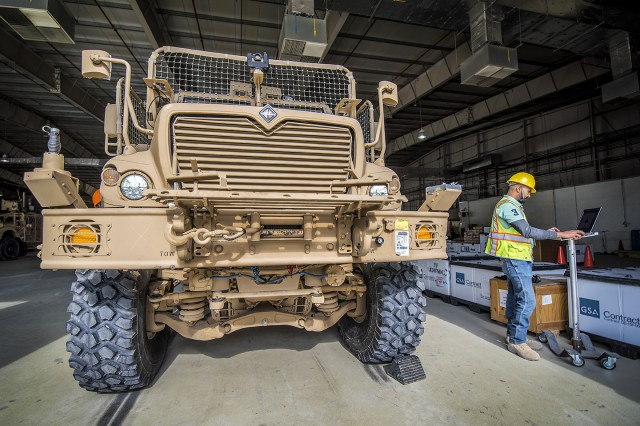 A MaxxPro A4 Mine-resistant, ambush protected (MRAP) vehicle is inspected by a contracted quality control specialist at Bagram Airfield, Afghanistan, March 12, 2019. The MRAP is part of a MaxxPro MRAP modernization effort led by the Army Field Support Battalion-Afghanistan, 401st Army Field Support Brigade. (U.S. Army Photo by Justin Graff, 401st AFSB Public Affairs)