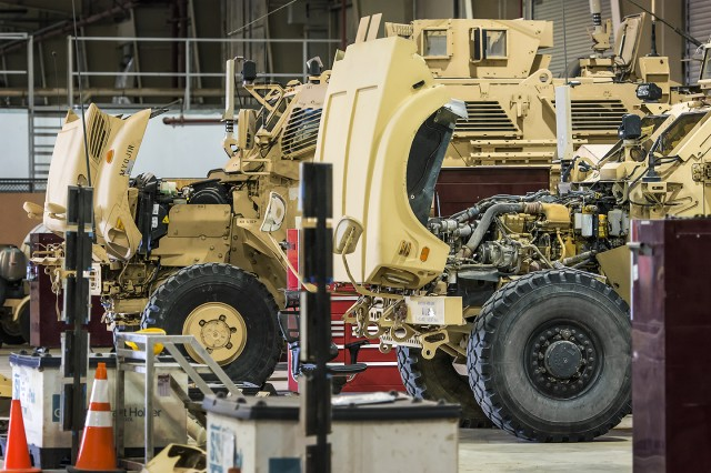 "Mine-resistant, ambush protected (MRAP) vehicles are undergoing thorough maintenance as part of the Logistics Task Force-Bagram Airfield ""racetrack"" at Bagram Airfield, Afghanistan, March 12, 2019. The ""racetrack"" is designed to convert a vehicle from a blank slate to fully mission capable and combat configured in seven days. (U.S. Army Photo by Justin Graff, 401st AFSB Public Affairs)"
